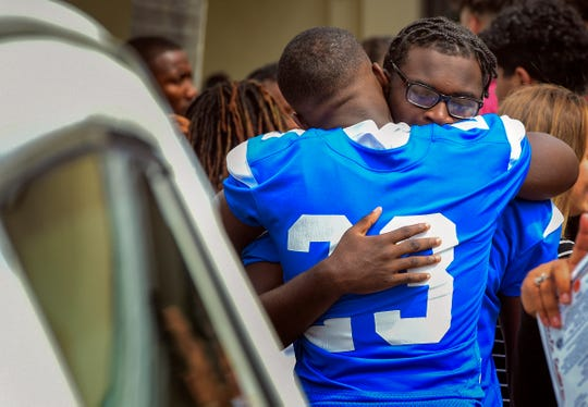 Sebastian River High School football player Emmanuel White (right) gets a hug from teammate Camren Clarke Saturday, Sept. 22, 2018, after the funeral service celebrating the life of their teammate, Kamaree Lyons, at Central Assembly Church in Vero Beach. Lyons, 17, a Sebastian River High School student and football player, died on Sep. 15 after collapsing on the court during a pick-up basketball game. To see more photos, go to TCPalm.com.