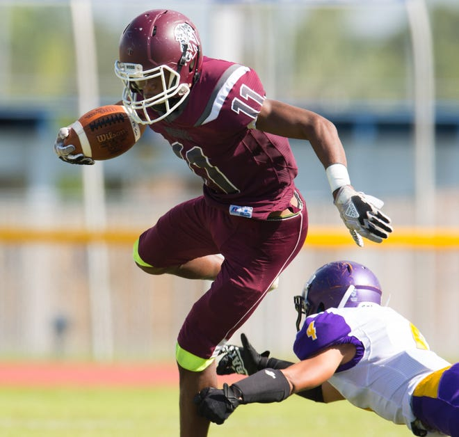 Fort Pierce Westwood wide receiver Willie Lewis slips a tackle during Showdown 39 against Fort Pierce Central on Saturday, Sept. 22, 2018 at Calvin Triplett Field at Lawnwood Stadium in Fort Pierce.