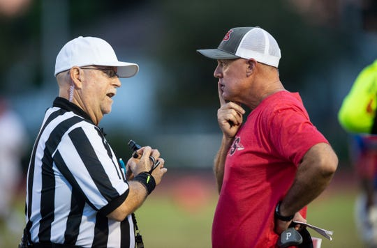 An official explains a call to Vero Beach coach Lenny Jankowski during the Fighting Indians game at Pahokee on Sept. 21, 2018.