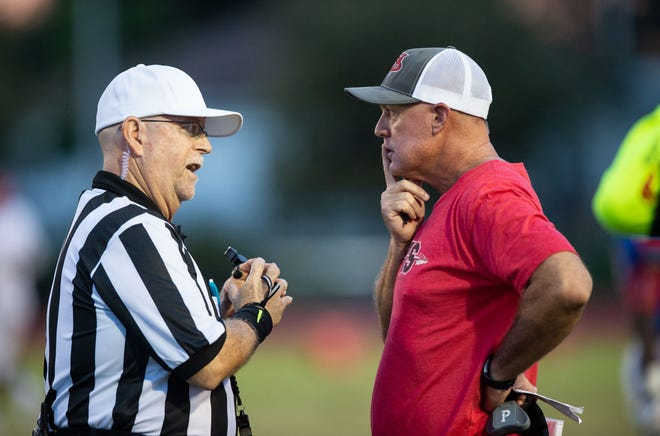 Vero Beach football coach Lenny Jankowski speaks to a referee during the Fighting Indians game against Pahokee in 2018.
