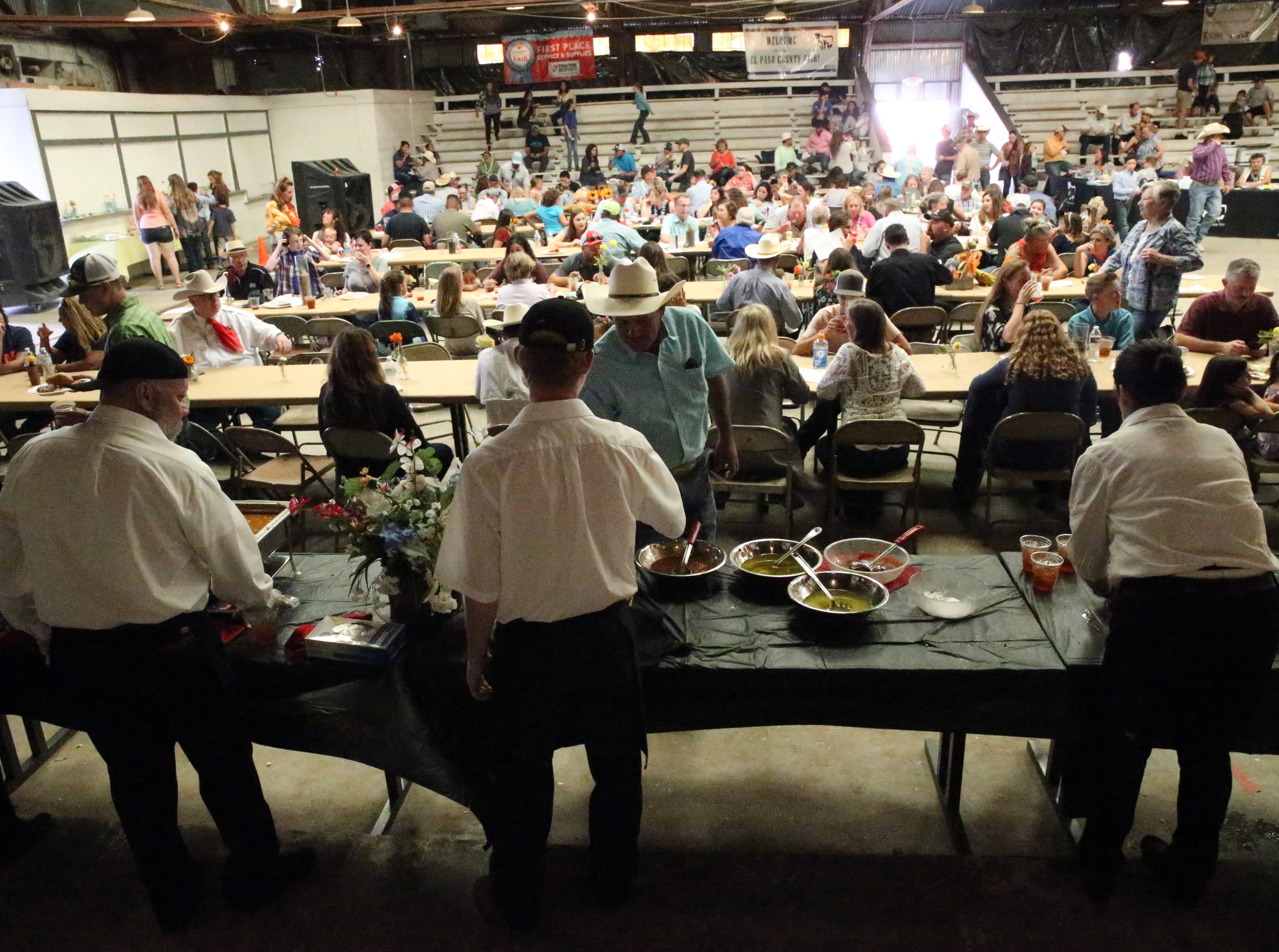 The serving line at the El Paso County Fair & Livestock Show auction Saturday at the Judging Arena behind the County Coliseum.