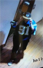 This woman is sought in the Aug. 28 burglary at the Moe's and Schlotzsky's Deli restaurant, 3261 Joe Battle Blvd., on the East Side. She was wearing a Chargers jersey with the number 91 and the name Merriman on the shoulder.