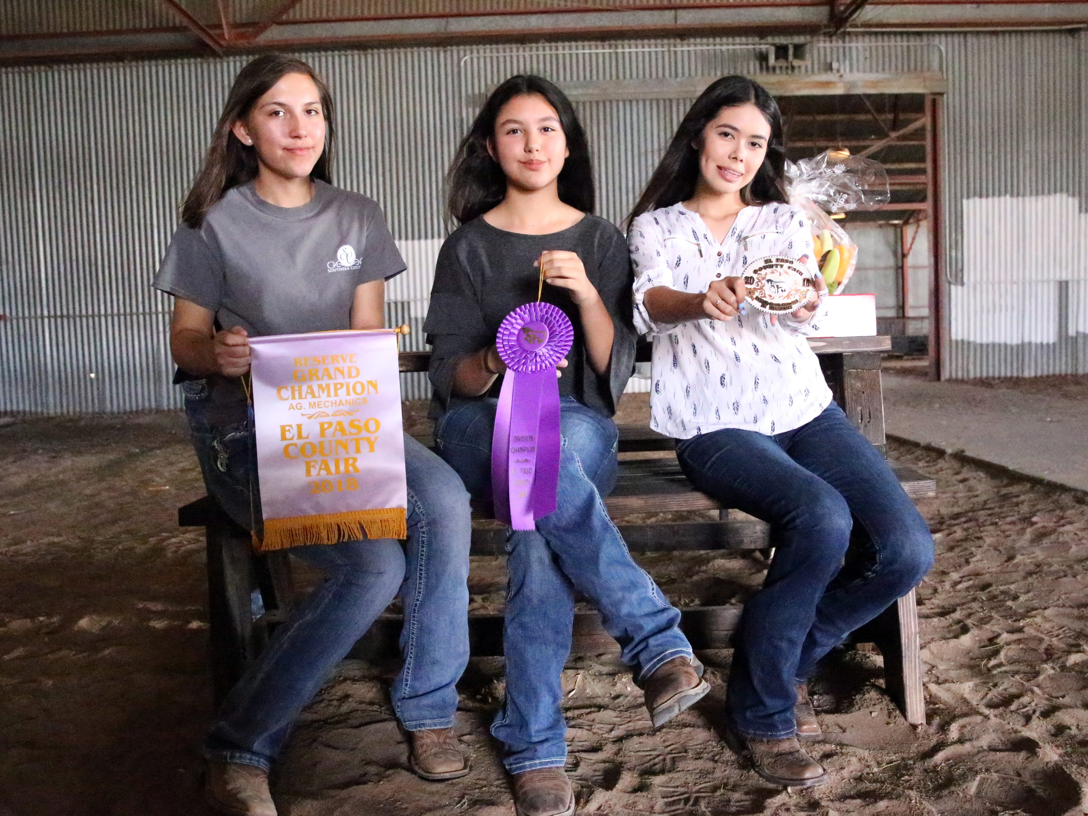 Kiana Baeza, left, Paloma Ponce and Sarah Maese of Clint Future Farmers of America show the awards they received for the wooden table and bench they built.