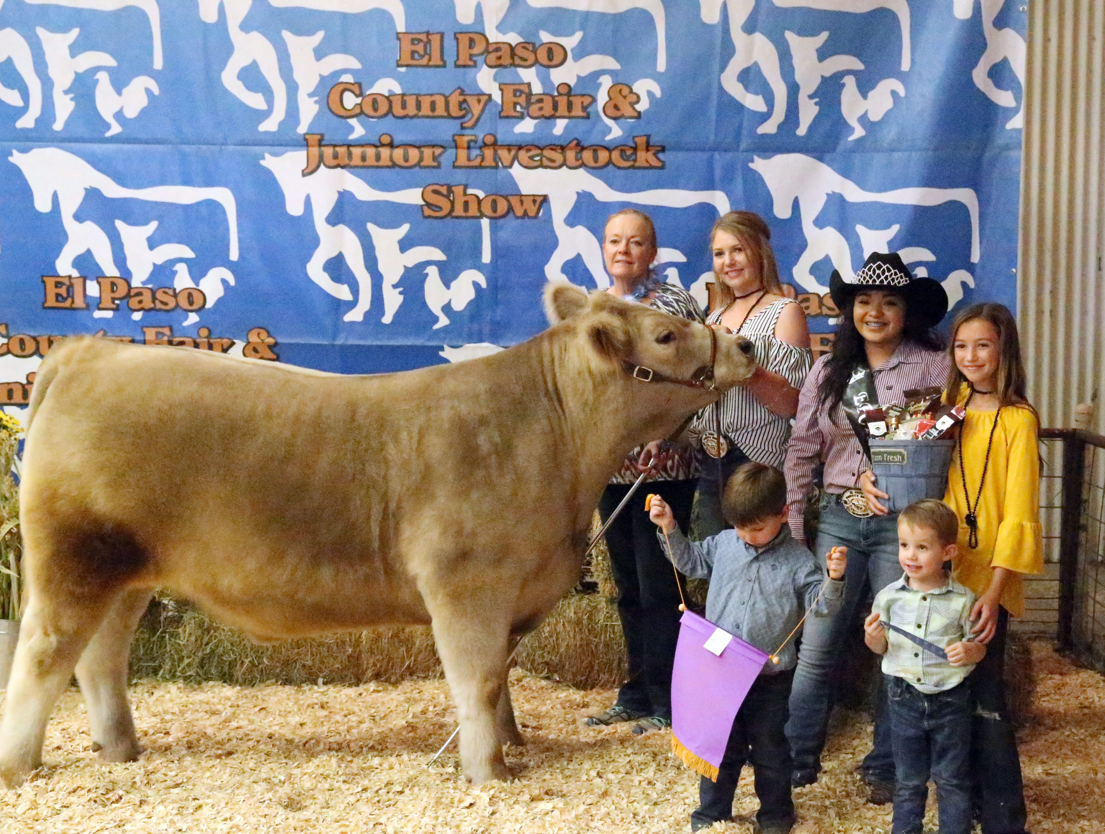 A photo with the Grand Champion market steer Saturday.