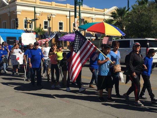 On Saturday, dozens of people protested the construction of the border wall in Downtown El Paso and the possible cancellation of the Hugs Not Walls event scheduled for Oct. 13.