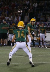 Moorpark High quarterback Blake Sturgill passes to receiver Noah Cronquist during a game against Simi Valley. Sturgill and the offense will be tested Friday night against a strong Grace Brethren defense.