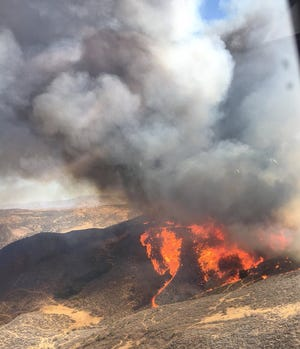 View of the Charlie Fire near Castaic from a Los Angeles County Fire helicopter.