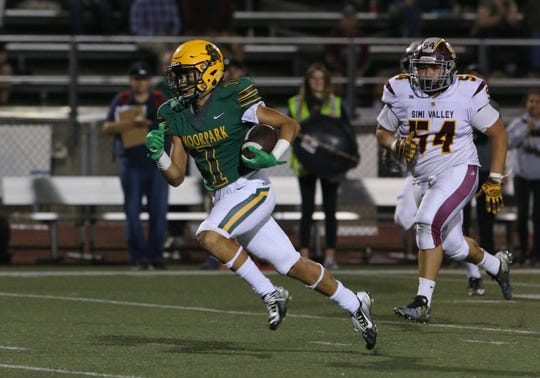 Moorpark High's Hunter Milton breaks free from the Simi Valley defense en route to a touchdown in the second quarter of Friday night's game.