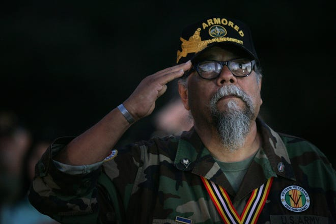 John Cabrera from Vietnam Veterans of Ventura County salutes the POW/MIA flag and the U.S. flag during the POW/MIA Day ceremony at the Ventura County Government Center last year.