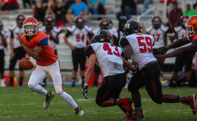 Millville quarterback Eddie Jamison Jr. looks to pass the ball against Kingsway at Millville High School, September 21, 2018.