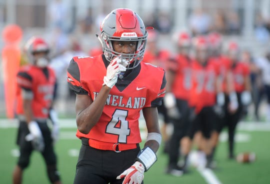 Vineland WR, Otis Harold (4) checks the sideline during a game against Timber Creek. The Fighting Clan lost to the visiting Chargers 24-10 on Friday, September 21.