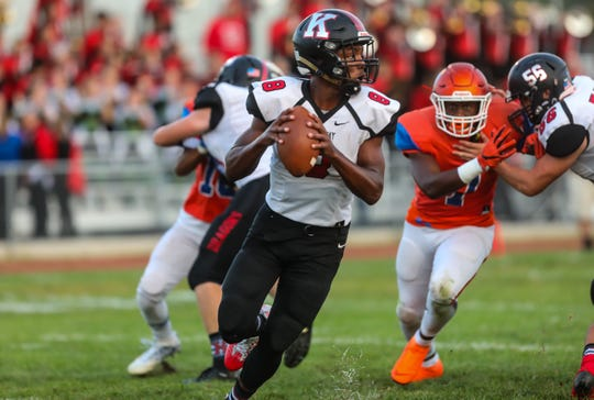 Kingsway quarterback Alex Odom looks to pass the ball against Millville at Millville High School, September 21, 2018.