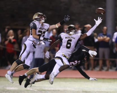 Clarkstown South's Jack Tucek (23) and RJ Lamarre (6) reach for a pass intended for Rye's Dylan Concavage during their game at Rye Sept. 21, 2018. Clarkstown South won 49-28. 23 6 28