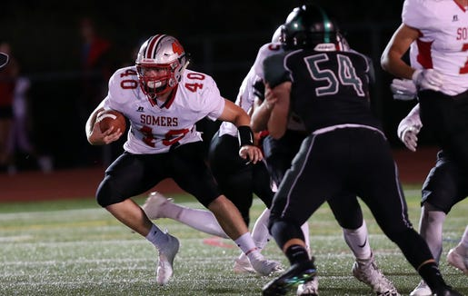 Somers' Charlie Grindrod (40) looks for some running room in the Yorktown defense during football action at Yorktown High School Sept. 21, 2018.