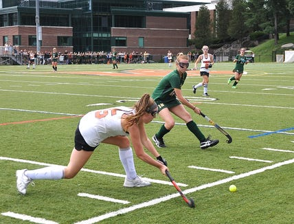 Mamaroneck's Sophie Showers prepares to drive the ball as Lakeland's Emma Halderman defends.
