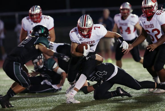 Somers' Charlie Balancia (7) looks for some running room in the Yorktown defense during football action at Yorktown High School Sept. 21, 2018.