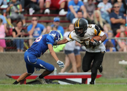 Nanuet's Sunny Chavan (24) pulls in a pass and looks for extra yards during the team's 14-6 win over Pearl River to claim the Little Brown Jug at MacCalman Field in Nyack on Sept. 22.