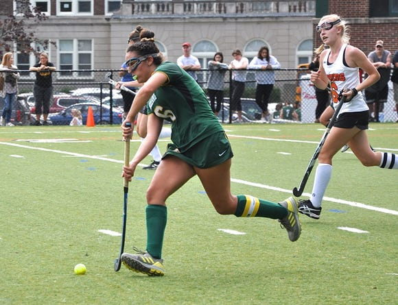 Lakeland's Emily Kness carries the ball up the field against Mamaroneck after making defensive stop.