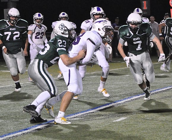 Brewster's Tom Consolato stops John Jay's Tommy Feinstein on a 7-yard catch and run during a football game at Brewster High School on Friday, September 21st, 2018.