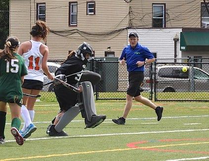 Mamaroneck goalie Samantha Maresca kicks a Lakeland shot away.