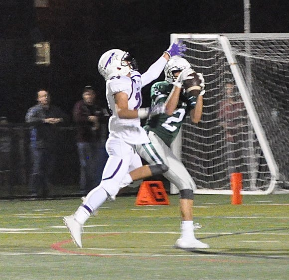 Brewster's Bobby McBride hauls in 55-yard touchdown pass from Joe Dominguez during a game against John Jay at Brewster High School on Friday, September 21st, 2018.