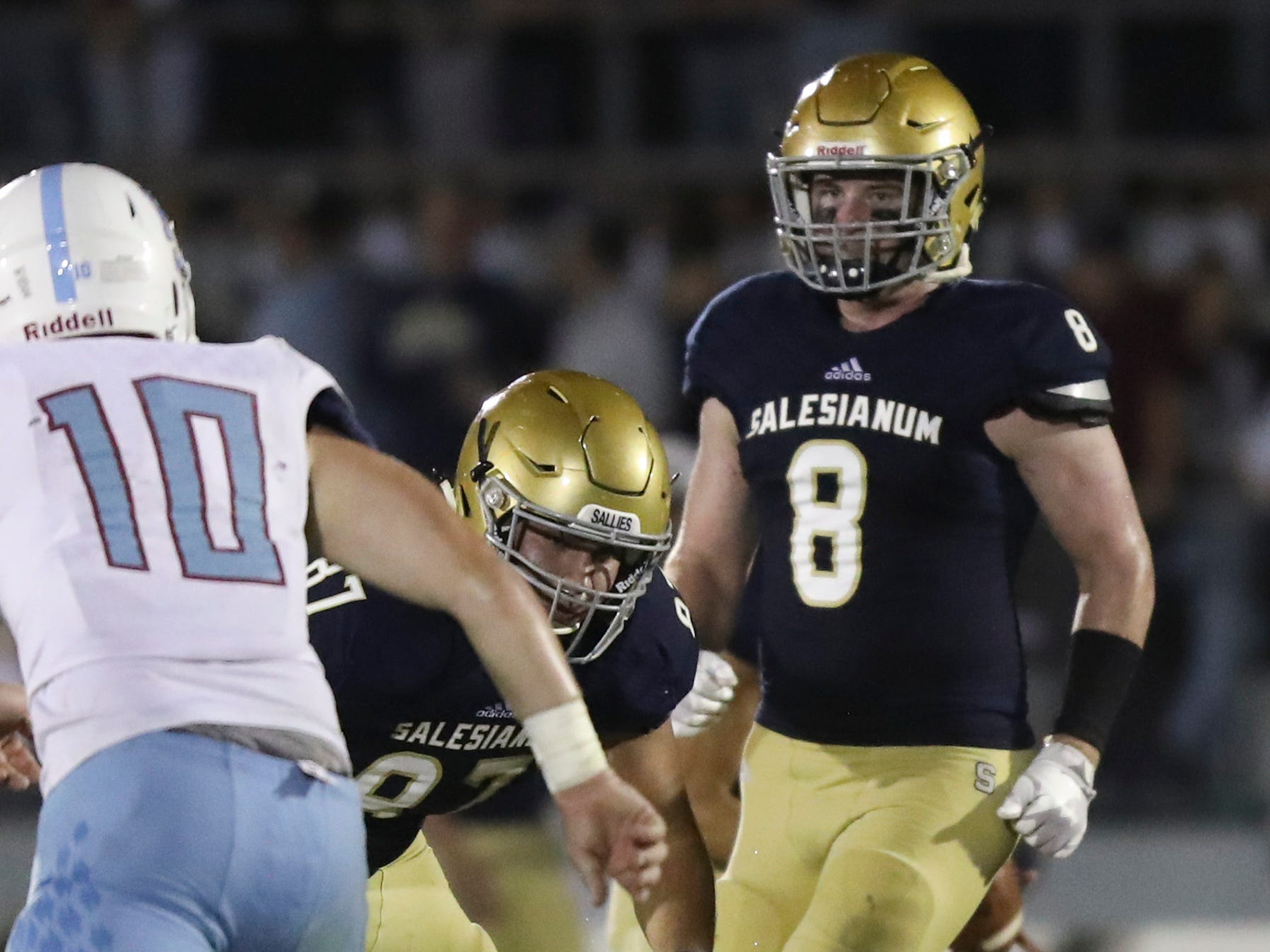 Salesianum's Luke Schneese (87) and Logan Bushweller move at the snap on offense in the second half of Salesianum's 21-14 win at Baynard Stadium Friday.