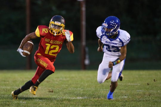 Sophomore receiver Robert Moran (left) tries to get past Brandywine's Caleb Yanovitch during Glasgow's 41-20 loss to the Bulldogs on Sept. 21, 2018.