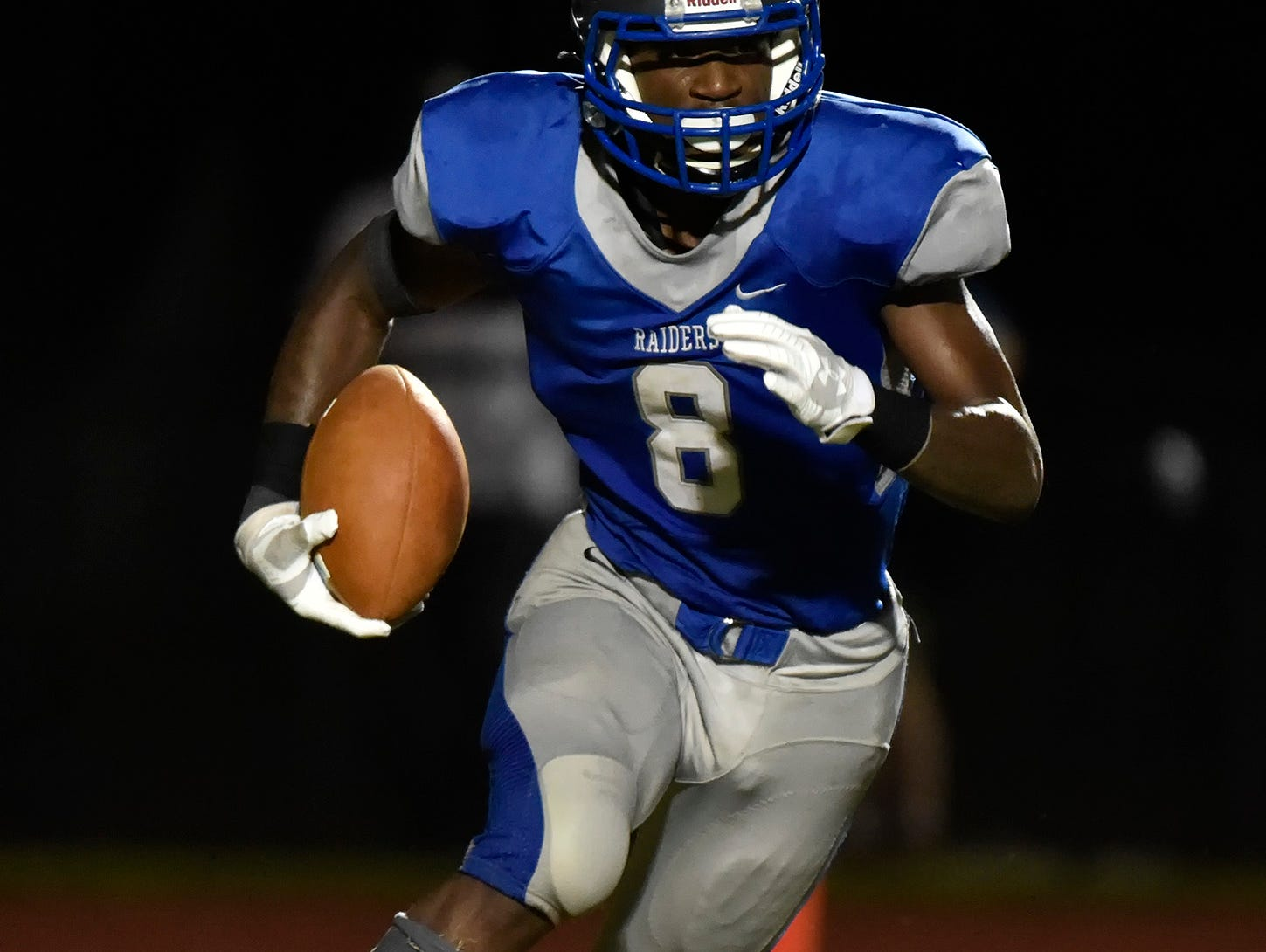 Woodbridge's Jamon Kane (8) runs with the ball in their home game against Wilmington Friends at Woodbridge High School.