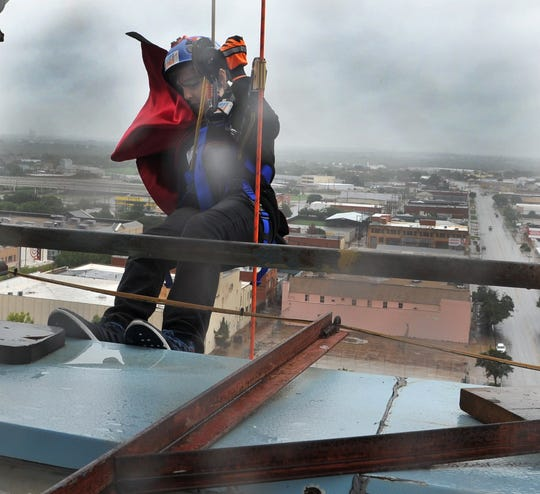 Weber Gilbert,12, appeared to have second thoughts as he prepared to rappel over the of the Wichita Falls downtown building, Big Blue, to help raise money for the River Bend Nature Center during the Go Over The Edge fundraising event.
