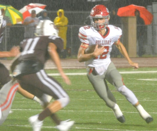 Holliday Eagles Running Back Connor Cox works to run the ball against Bowie Jackrabbits Evan Kennedy Friday night in Bowie