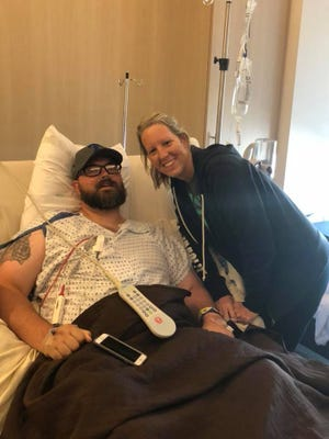 Wichita Falls police officer Tim Putney with his wife Chelsea Putney in a Metroplex hospital on Sept. 19, the day before his second spinal surgery.  Chelsea has been there for her husband as he has gone through the difficulties of an on-the-job-injury he sustained July 11, 2017, and seeking medical care through the workers compensation system since then. The couple hopes the operations Tim had last week will get him on the road to recovery.