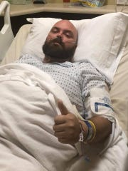 """Wichita Falls police officer Tim Putney underwent one complicated surgery last week on Sept. 17 only to find out that he would need a second operation because surgeons needed to go in at a different angle to reach a pinched nerve, his wife Chelsea Putney wrote in a Facebook post. This picture shows Tim on Sept. 20 just before the second operation. Chelsea said Tim asked every doctor or nurse who walked in how his or her day was going. """"He amazes me every day,"""" Chelsea wrote. """"He has such a good heart."""" Tim was injured in the line of duty on July 11, 2017. The 30-something father of two who once ran marathons and rode a bicycle has been walking with a cane. The Putneys hope the surgeries will get him on the road to recovery."""