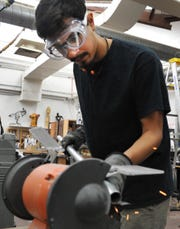Wichita Falls Dome designer Erick Zambrano works to smooth rough edges of a part that will be used to construct the Dome structure that will be built in Nexus Square near downtown. The project is the brainchild of the Wichita Falls Alliance for the Arts and Culture.