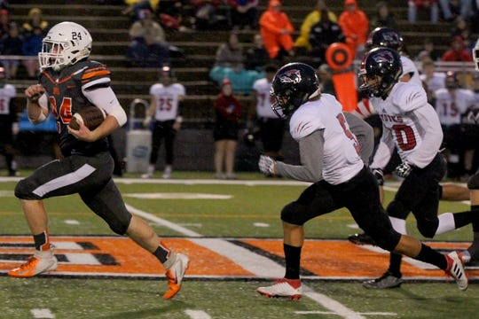 Austin Childs and the Burkburnett Bulldogs will try to run away from the Wichita Falls High Coyotes Friday at Memorial Stadium.