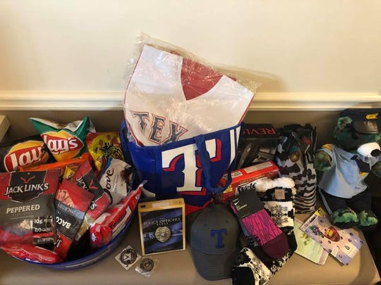 Since Wichita Falls police officer Tim Putney entered the hospital for his first back surgery on Sept. 17, the Peace Officers Angels Foundation has been checking on he and his wife Chelsea daily and bringing snacks, food, necessities and law-enforcement swag from all over the Dallas-Fort Worth area, Jessica Edwards, family friend and Wichita Falls businesswoman, wrote in a Facebook post Sept. 19. POAF assists officers injured in the line of duty. Tim had two operations last week to help him recover from July 11, 2017, injuries he sustained on the job.  Edwards is raising donations for the nonprofit organization on her Facebook page at this link: https://bit.ly/2PWOgfY