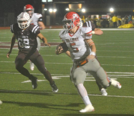 Holliday quarterback Jett Johnson looks for running room Friday against Bowie.