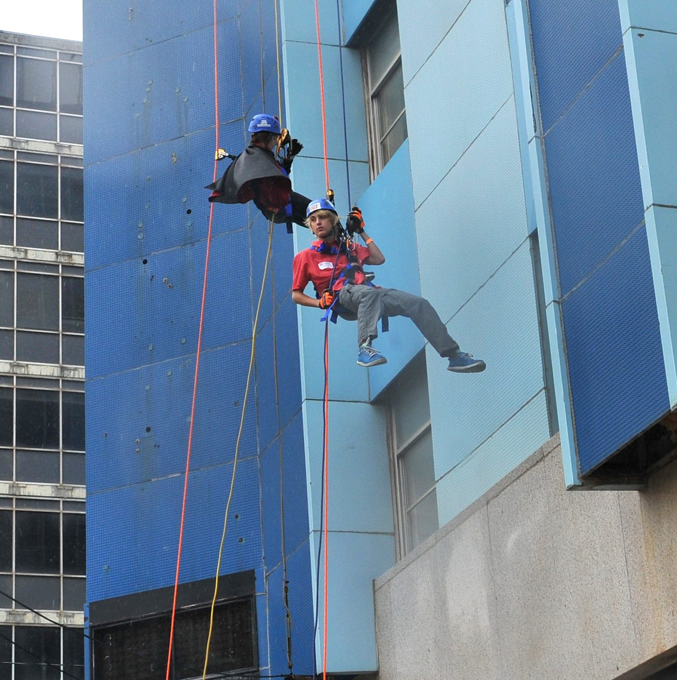 Tall tales after volunteers rappel off 12-story Big Blue to raise money