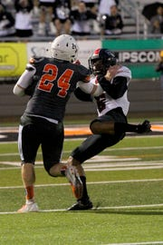 Uriel Vigil of Wichita Falls High School makes the tackle on Burkburnett's Austin Childs to save the touchdown Friday evening as the Coyotes traveled to Burkburnett for Friday night action.