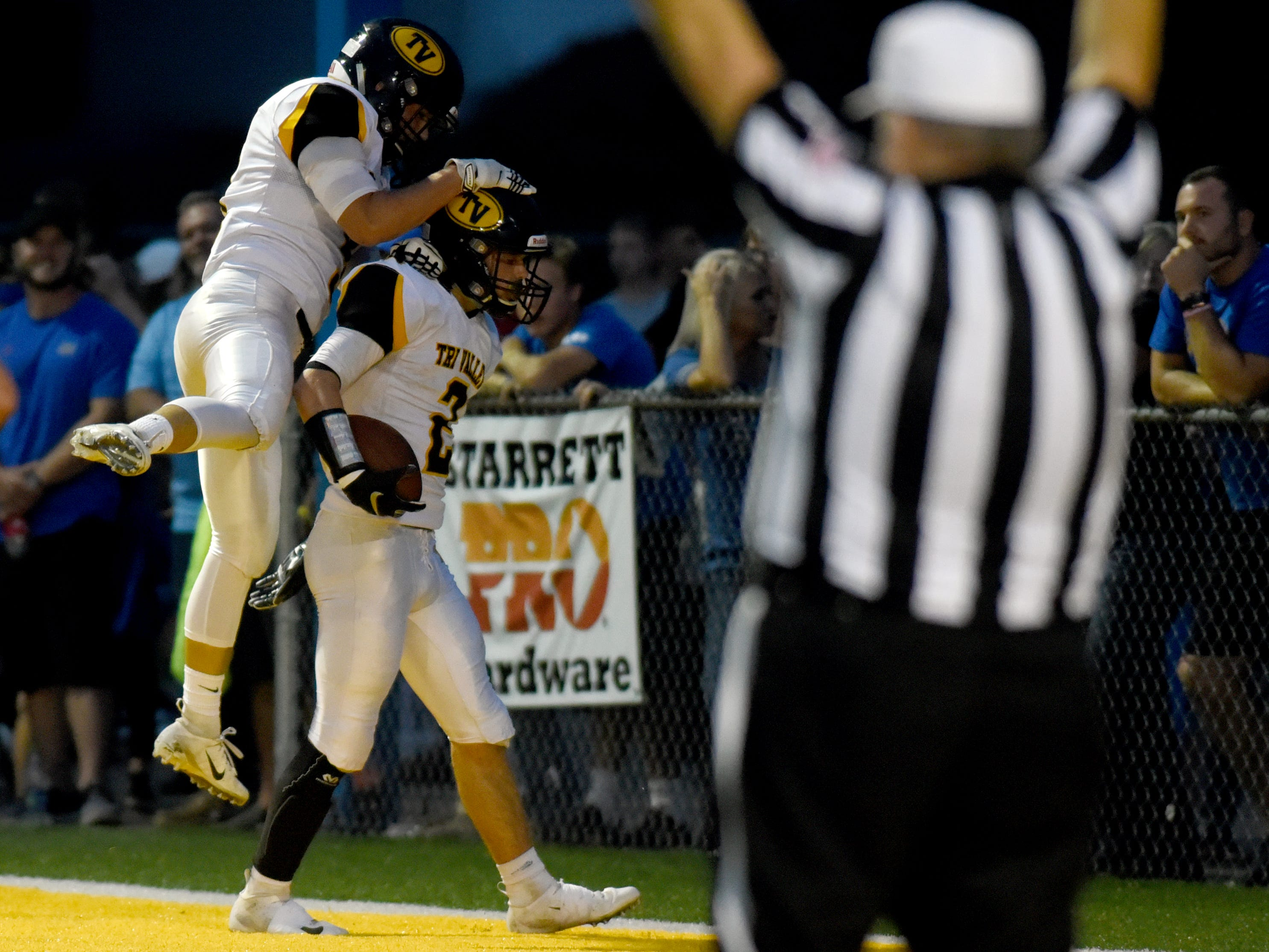 Tri-Valley's Blayze Taylor celebrates in the end zone after returning a punt for a touchdown in the second quarter against Philo on Friday night at Sam Hatfield Stadium. The Scotties won, 28-14, to remain unbeaten.
