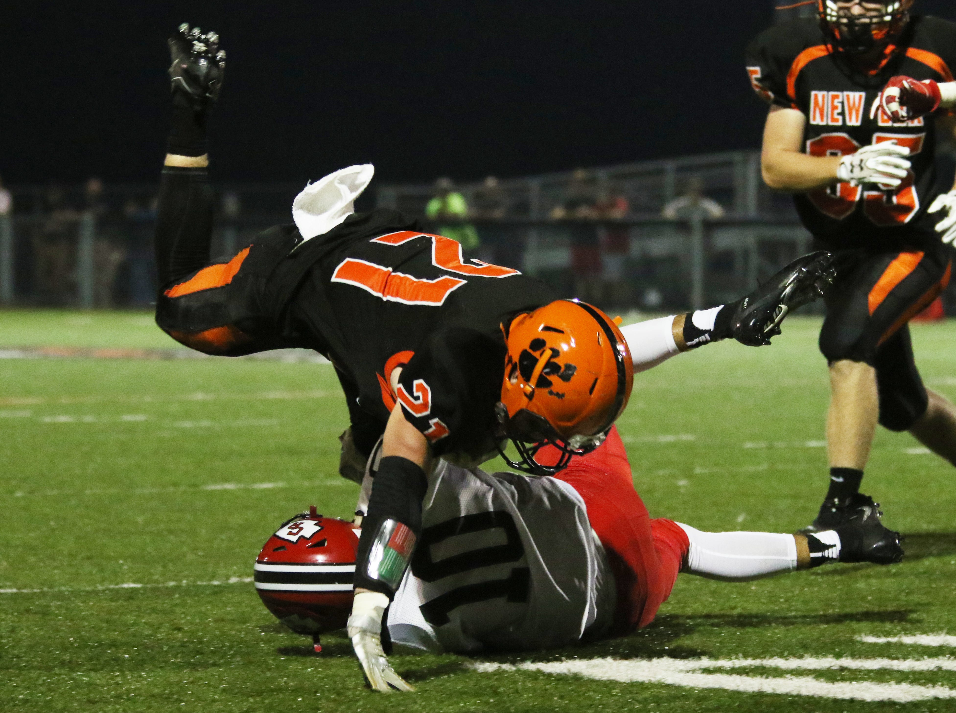 New Lexington's Christian Vance is upended by Coshocton's Nathan Fauver.