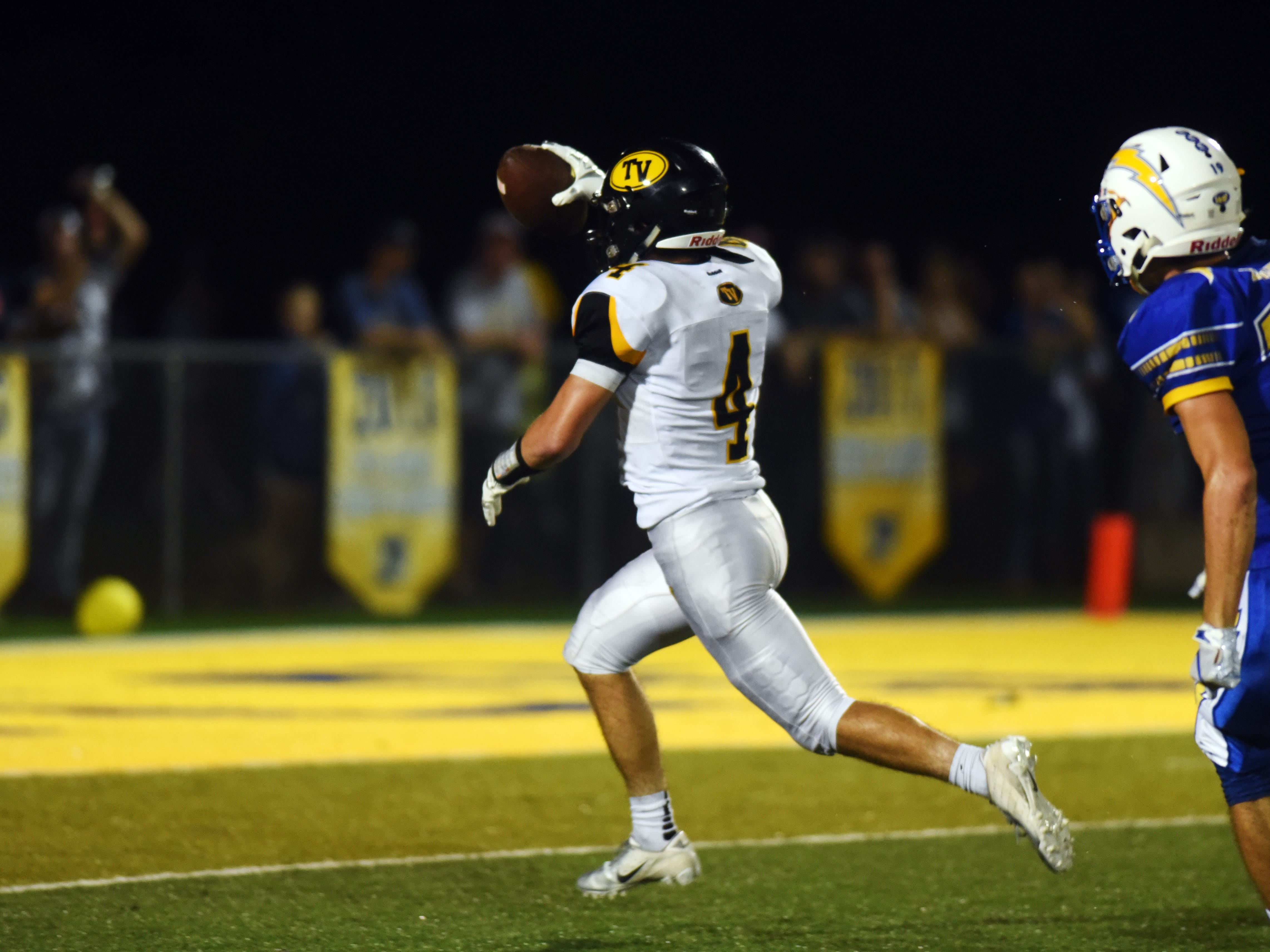 Carson Simpkins, of Tri-Valley, sprints into the end zone with the go-ahead touchdown in the fourth quarter of Tri-Valley's 28-14 comeback win against Philo on Friday night at Sam Hatfield Stadium.