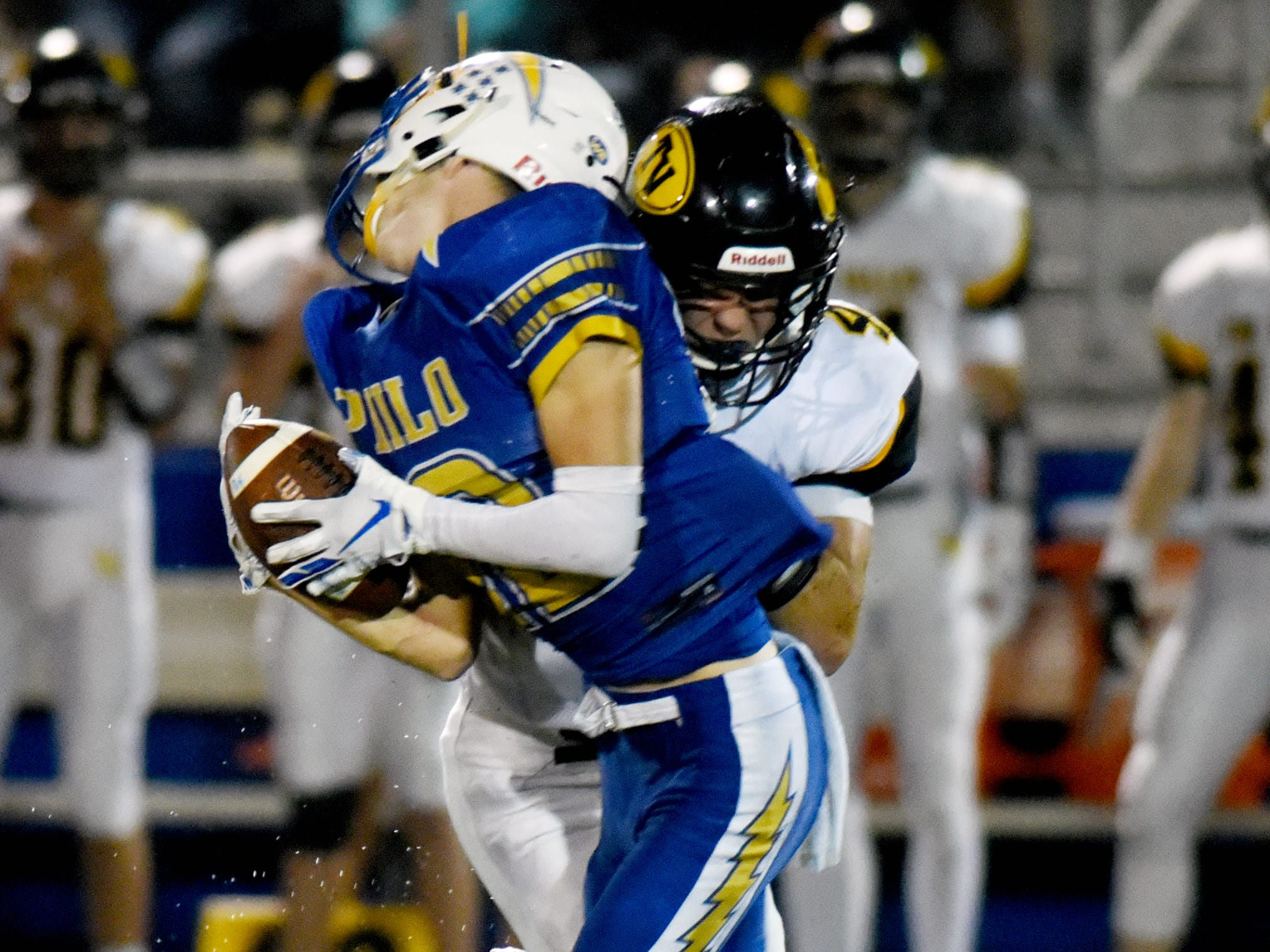 Carson Simpkins, of Tri-Valley, lays a crushing hit on Philo's Aaron Philip during the first half of the the Scotties' 28-14 win on Friday night at Sam Hatfield Stadium.