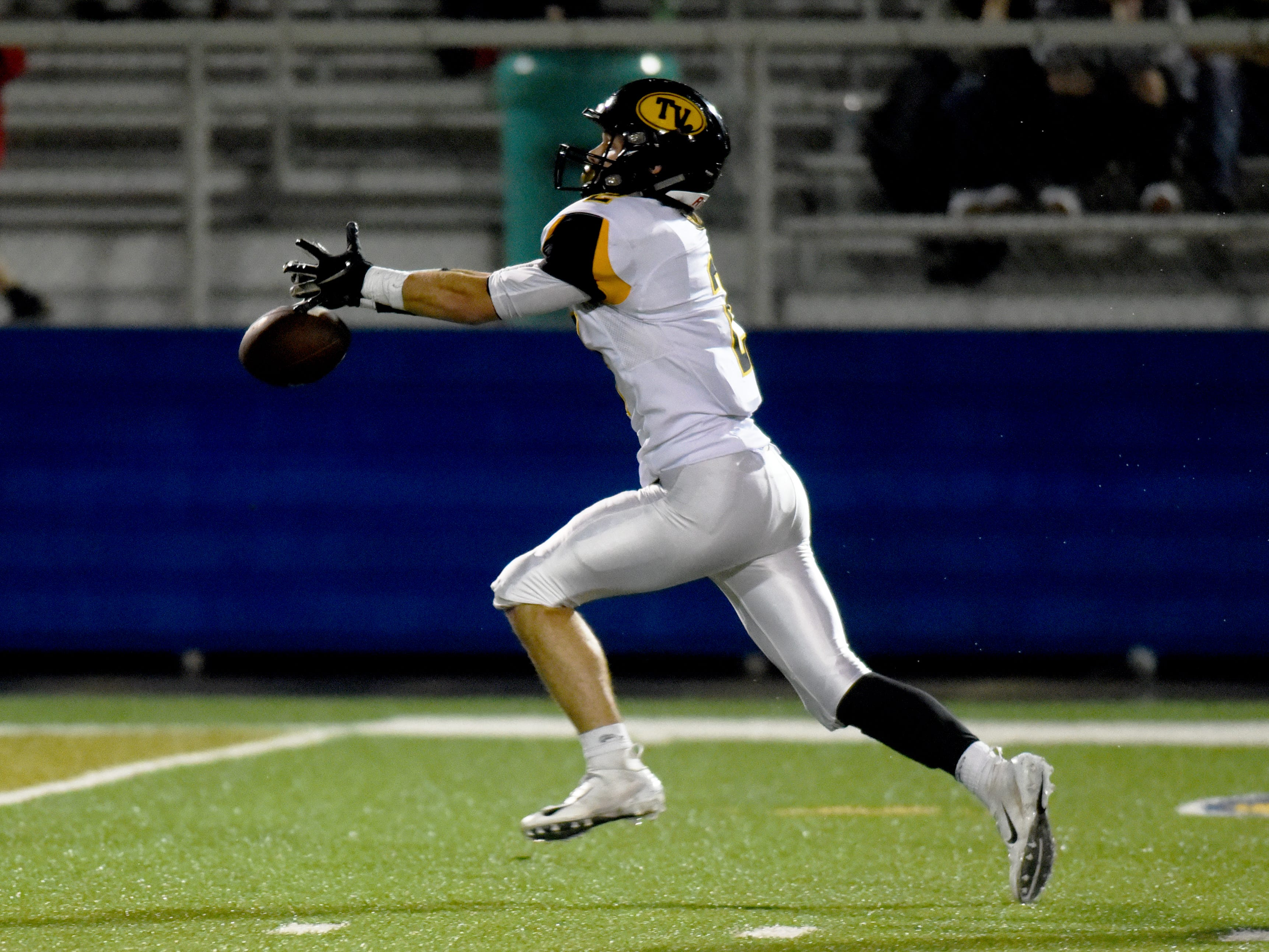 Tri-Valley's Blayze Taylor barely misses making a long reception on Friday night against Philo.