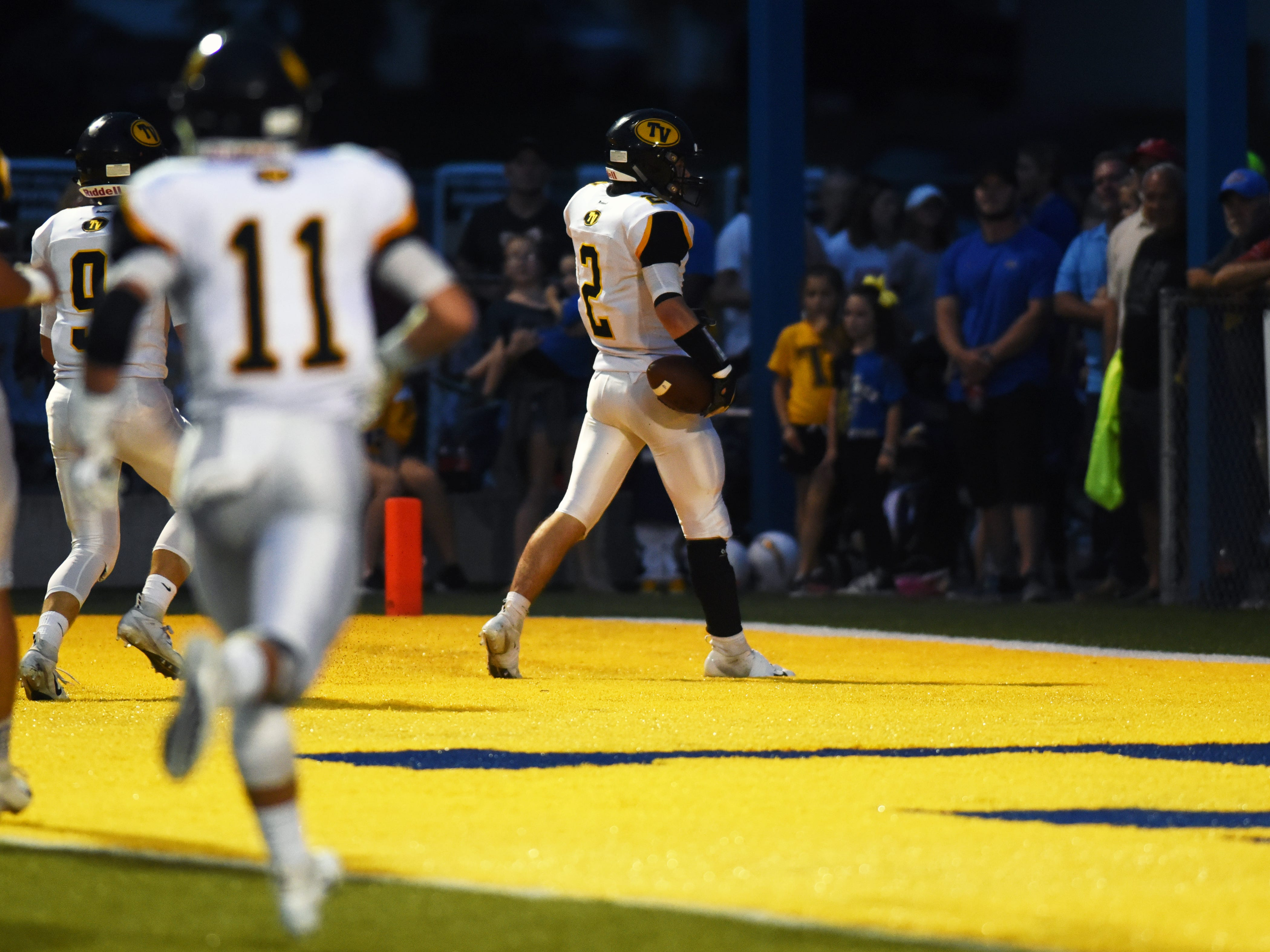 Tri-Valley's Blayze Taylor celebrates in the end zone after returning a punt for a touchdown against Philo on Friday night at Sam Hatfield Stadium.