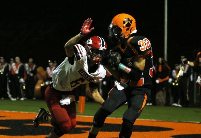 New Lexington's C.J. Ratliff pulls in a touchdown pass against Coshocton.