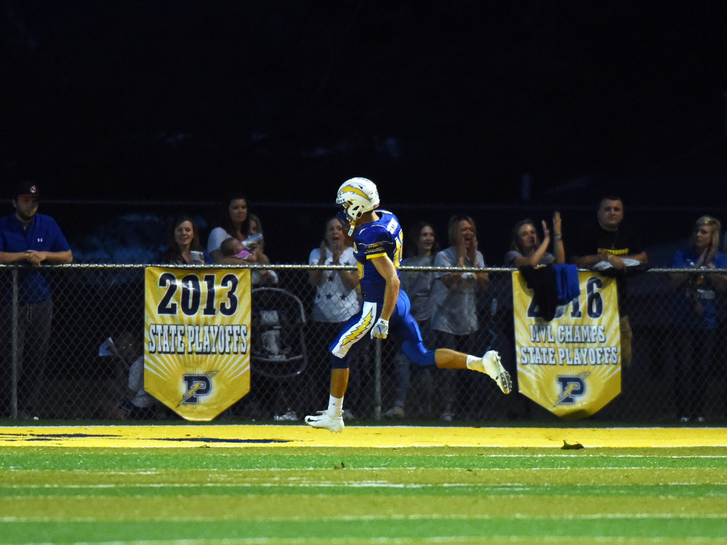 Carson Stottsberry runs into the end zone during a 78-yard touchdown reception on Friday night at Sam Hatfield Stadium.