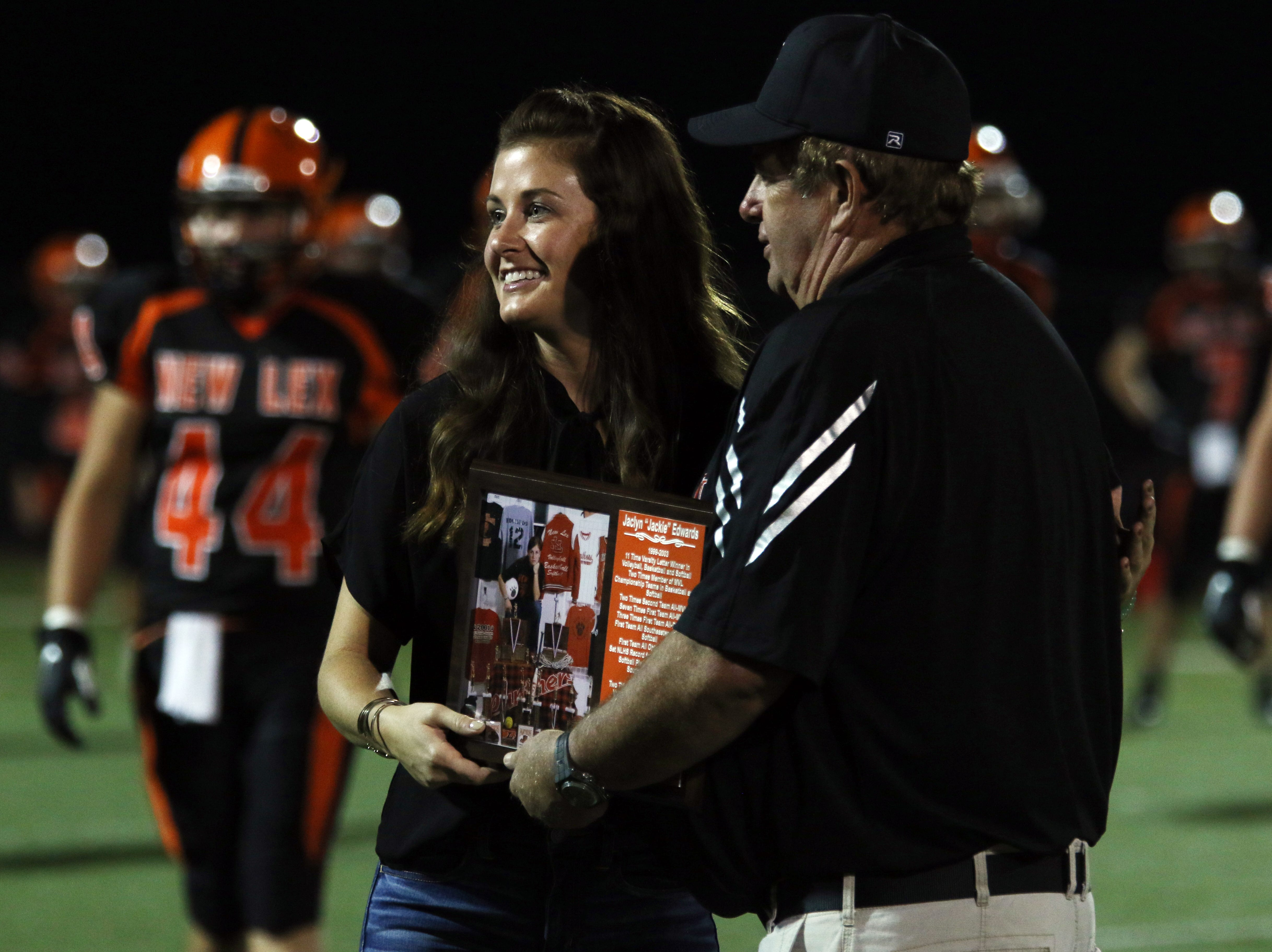 New Lexington's Jaclyn Edwards is inducted into the school's Hall of Fame Friday night.