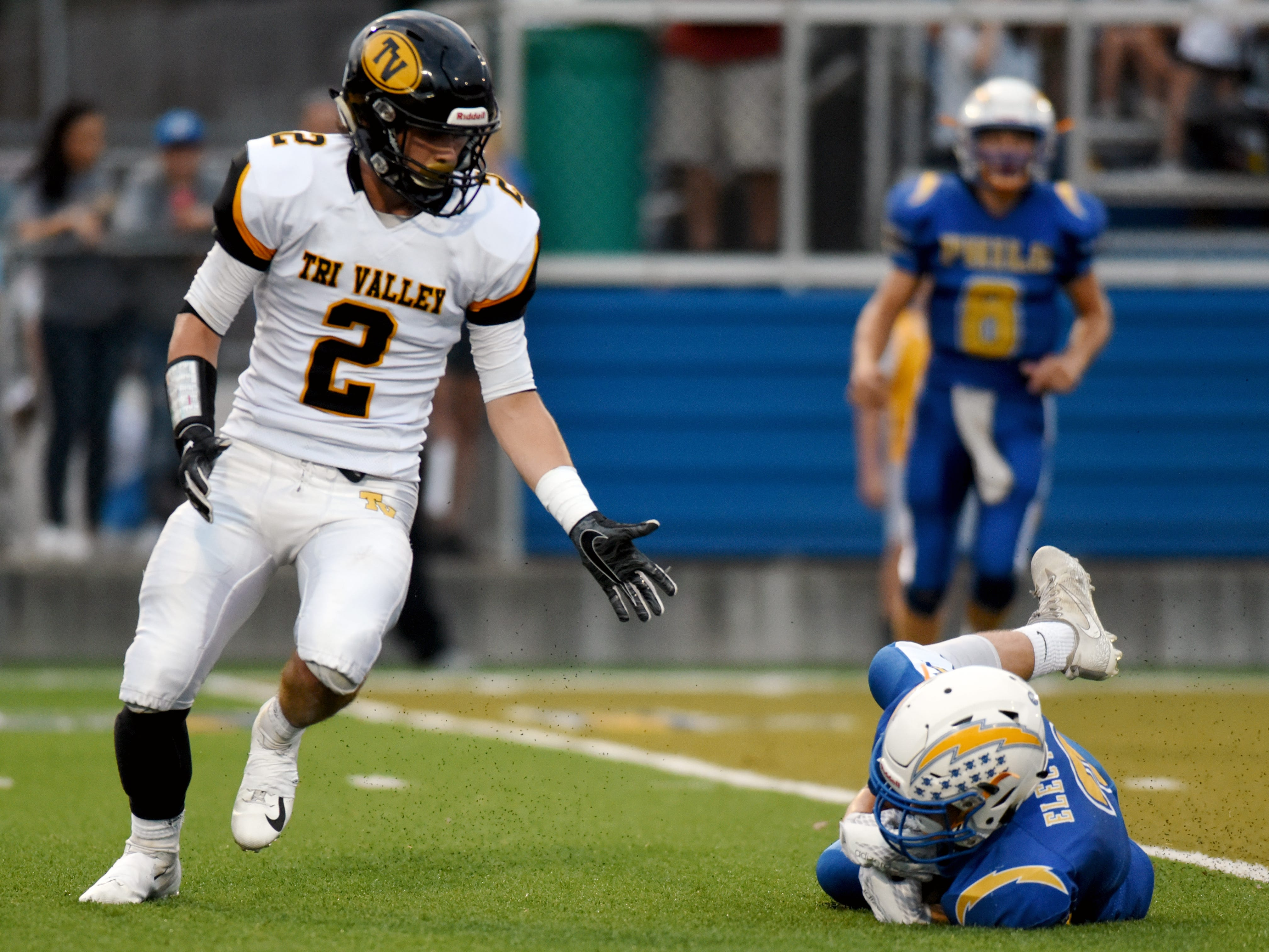 Philo's Ashlin Bailey, right, appears to make a diving interception in front of Tri-Valley's Blayze Taylor in the first half on Friday night in the Scotties' 28-14 comeback win on Friday night at Sam Hatfield Stadium.