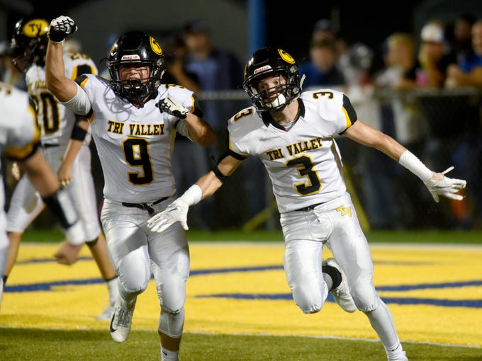 Sam Slaboden, left, and Cade Sterling celebrate after Tri-Valley made a goal-line stand in the fourth quarter during the Scotties' 28-14 win against Philo on Friday night at Sam Hatfield Stadium.