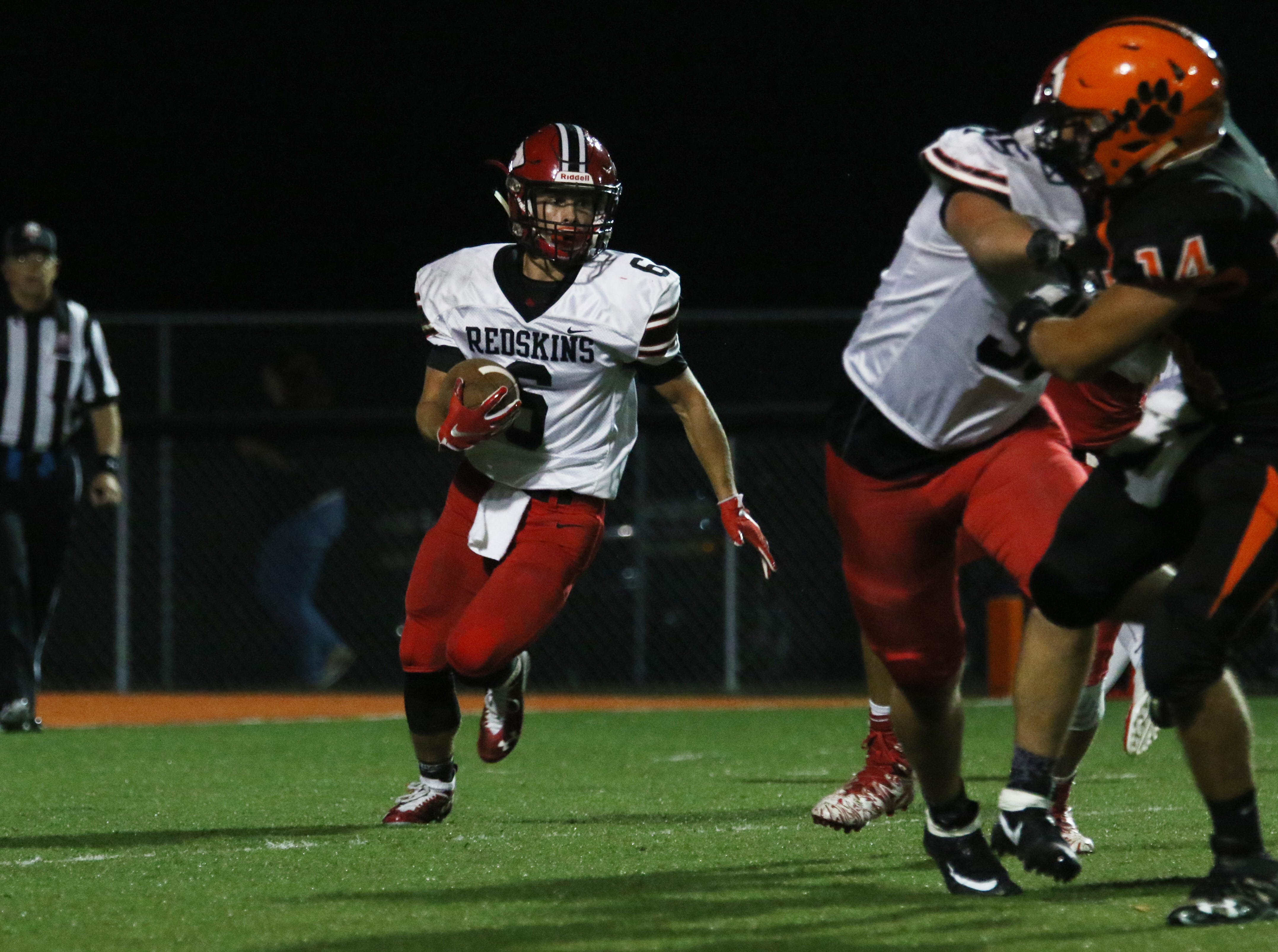 Coshocton's Andrew Kittell carries the ball against New Lexington.